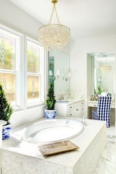 Traditional Master Bathroom with complex marble tile floors, Undermount sink, Raised panel, Complex Marble, Flush