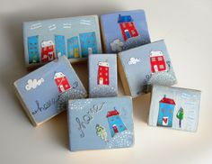A selection of woodblocks with wee  houses from recycled tin