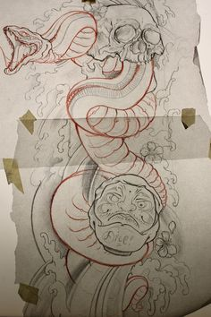 snake skull and daruma
