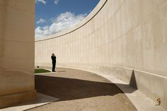 A man looks at the names of the dead at The National Memorial Arboretum near Lichfield, Staffordshire