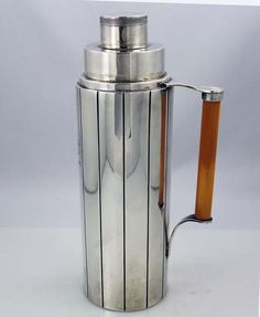 Art Deco Watson sterling silver cocktail shaker with catalin (bakelite) handle.