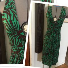 "Green Brown palm V plunge midi stretch dress 2/4 Beautiful dress by Veronica M. Worn probably 1x and in mint condition! Kelly green and chocolate brown, stretchy form fit fabric adjusts   And flexes with the body curves! Empire high waist, plunge V neckline front and back, just stunning! Mid length dress -- 42"" from the shoulders. Size on tag S but fits from 2-4 maybe a slim 6 USA.  NOTE: PHOTOS 1&2 are posted on size 4 form, PHOTOs 3&4 are posted on size 2 form. Veronica M Dresses Midi"