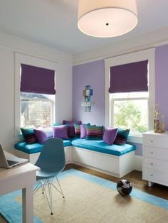 I love this purple and teal color scheme! Perhaps this is how I can transform Taylor's already purple room! Just a pop of teal. love the rug too on the hardwood, perfect.
