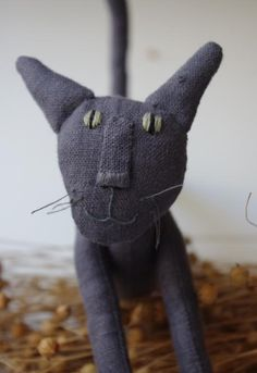 by adatine..reminds me of the kitty from Coraline...I think it is the kitty from Coraline! ^.^