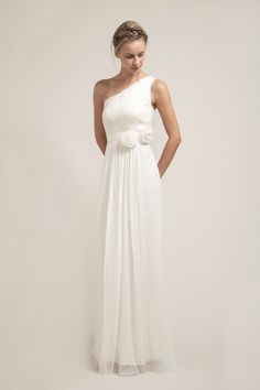 HB6225 l Elegant one shoulder wedding dress flows effortlessly on the bride. Soft gathering around the front and back skirt waist enhances its effectively understated beauty. It has a detachable silk flower sash that should be tied off to the side.