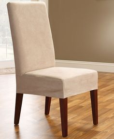 Renew your dining room chair with luxury and style. Featuring a soft look and feel combined with the durability and ease of care you can expect from Sure Fit, with a short skirt that allows the beauty