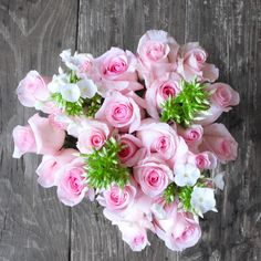 It's time to go Above & Beyond regular flowers with this signature bouquet. Pink Roses accompany White Phlox for a real expression of love and gratitude. Our flowers ship direct from eco-friendly, sustainable farms on a Volcano to your recipient's door. With Free Delivery.
