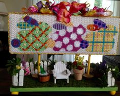 Associated Talents bunny banner needlepoint finished as a Spring Display Platform, stitching by Dani C. with Luv2stitch for finishing.