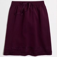SALE!! J. Crew Drawstring Miniskirt Gorgeous J. Crew miniskirt in a rich eggplant/purple. Never worn with original tags still attached. This item sold out instantly! Last photo is for style inspiration only. J. Crew Skirts Mini