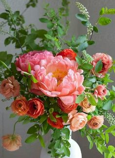 Spring bouquet of ranunculus, peonies and choke cherry sprigs.