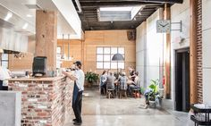 The serving line of Proud Mary's large, open kitchen was created using handmade maple shelves, and the space's original 1920s brick.