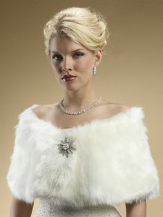 A luxurious and elegant 1920s inspired Faux Fur Bridal Wrap in Ivory fox that will help you have both warmth and glamour at any autumn or winter weddings.