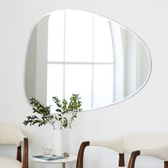 We gave this mirror a delicate beveled edge in lieu of a frame. Sleek and modern, it blends in anywhere.