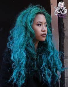 A long loose wavy invisible part wig made in teal.Looks very natural, you won't find this unique invisible u-part wig anywhere else!