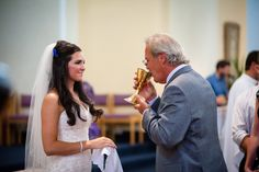 We served the Blood of Christ to our guests at our Catholic Wedding Mass to show that our first act as a married couple is an act of service to those who love and support us.