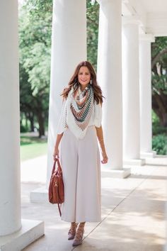 The Miller Affect wearing an ivory blanket scarf and nude palazzo pants