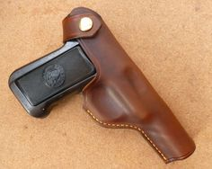 Custom makeitjones hand made leather belt holster for the classic '10 rounds quick!' Savage model 1907 & 1917 automatic pistols. Other designs available on request.