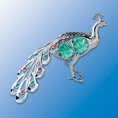 Peacock Profile Sun Catcher with Swarovski Crystals  --  mThe peacock, one of nature's most colorful creatures. We bring to you this chrome finished peacock sun catcher adorned with Swarovski crystal elements to represent the best in peacock colors. Your window or mirror will love hosting this great bird when it sparkles as it catches the light.