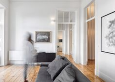 Marble bathrooms and simple furnishings complement period mouldings and restored wooden floorboards inside this Lisbon apartment renovated by Rar Studio