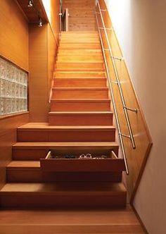 Hidden drawer in the stair riser.