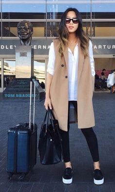 Long vest + white shirt + black skinny jeans + black shoes