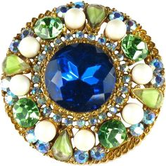 This ART Blue Green Rhinestone Brooch will have you dreaming of Caribbean cruises. Swim on over to the Ruby Lane shop Anna's Vintage Jewelry to capture it.