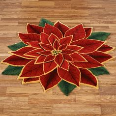 Trimmed in gold, this Elegant Poinsettia unfurls its petals in a lovely opulent splendor. This polyester rug resembles a freeform realistic poinsettia blossom. Christmas Rugs, Christmas Poinsettia, Christmas Mood, Christmas Decorations, Christmas Things, Crochet Christmas, Christmas Angels, Table Topper Patterns, Homemade Rugs