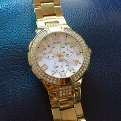 GUESS Gold Watch Guess gold toned women's watch featuring swarovski rhinestones. 100 meters/ 330 ft water stainless steel. Absolutely gorgeous & works perfectly! Preloved & in good condition. Doesnt come with additional links or box. CHEAPER VIA Ⓜ️ Guess Accessories Watches