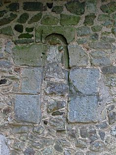 Blocked Norman window on the north wall of the chancel (exterior).  Photos of All Saints church, Brill, Buckinghamshire, England.  All Saints is a Grade II* Listed Building, for more information follow this link to the Heritage Gateway: www.heritagegateway.org.uk/Gateway/Results_Single.aspx?ui...
