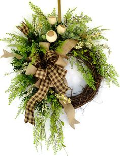 Beautiful Country Burlap Wreath, All Year Wreath Everyday Wreath, Greenery Wreath. This Gorgeous Country Wreath is full of lush greenery from Eucalyptus to hanging Maiden Hair Ferns and many other additions such as the creamy Bell Cups, berries with trailing vines and rich green mint leaf.  The large Burlap Bow gives an air of country with its added addition of a chocolate brown and tan checked bow. You will love a simple but elegant enhancement to your front door with this beauty which is…