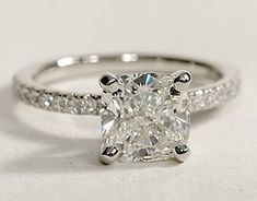 Delicate and beautiful, this diamond engagement ring in platinum features a half circle of sparkling petite pavé diamonds to complement your center diamond. Setting includes 1/4 carat total diamond weight.