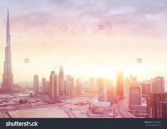 Beautiful sunset over Dubai city, amazing cityscape lit with warm sun light, contemporary new modern architecture, view from above on a luxury property of United Arab Emirates