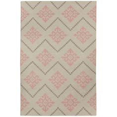Pink and brown rug. Inspired by Scandinavian needlework, designer Genevieve Gorder fuses a traditional design with modern details to create the Flakes rug for Capel. Its diamond medallion pattern is presented in an on-trend peony pink and brown colorway.