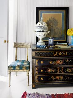 In the downstairs guest room, a French Directoire chair with original ikat upholstery from Matthieu Monluc in Paris and a 19th-century French painted commode topped with an oversize 18th-century faience potpourri vase, an Emilio Terry drawing and a photograph of Ian's daughters as little girls, in an antique frame given to Emilie as a child. (Photo: Simon Watson)