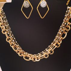 Lorena Necklace - What a beauty this multi-strand necklace of silver and gold mixed with thick multi-link satin chain.  (Shown with the Frozen Earrings with diamond shape pendants) - $84.00