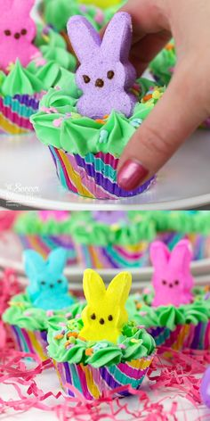 "Peeps Easter Bunny Cupcakes 🐰🧁 These cute & colorful Peeps Bunny Cupcakes are the perfect Easter party dessert! Kids will love the bunnies playing ""peek-a-boo"" in the frosting! Easter Bunny Cupcakes, Easter Peeps, Easter Candy, Easter Cake Easy, Easter Stuff, Hoppy Easter, Easter Snacks, Easter Treats, Easter Recipes"