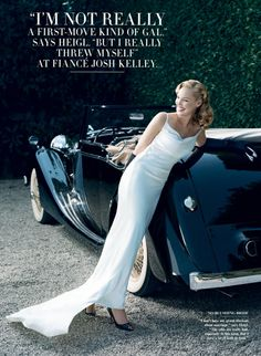 norman jean roy photo.  This shot with our candy red 1960 Corvette convertible.   A white dress to the ground, black heels?  Hair slightly up, dramatic makeup that still claims innocence.
