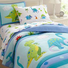 Prehistoric fun! Our Dinosaur Land comforter/quilt has rows of adorable dinosaurs roaming across the bed. Each of the dinosaurs are outline stitched. Super soft all cotton! Back is solid. The coordinating shams feature a T-rex with embroidered details and a plush cloud.