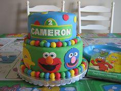 Primary Colored Polka Dot Sesame Street Characters Cake (Cameron)