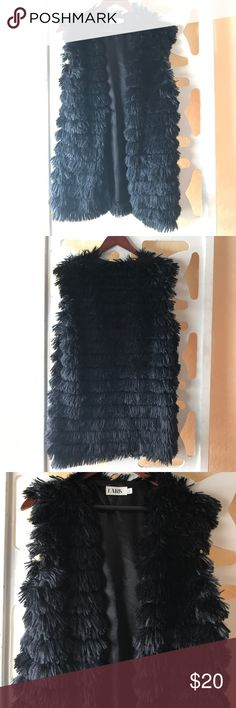 Lark Faux Fur Vest This is a Lark Faux Fur Vest. NEVER WORN. I have so many favorite faux fur vests, I haven't had the opportunity to wear this one. Super cute tiering throughout💕💕💕 100% polyester. Dry clean. Lark Other