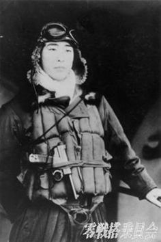 Japanese fighter pilot with his nambu pistol
