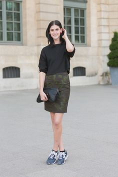 Diane Conterato in an army print pencil skirt and basic black sweater. Paris #Offduty