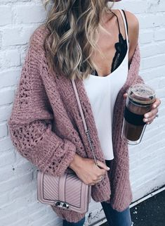 Mauve knit cardigan over white tee and blue jeans.