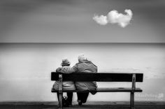 Old Couple On Bench Looking Out To Sea