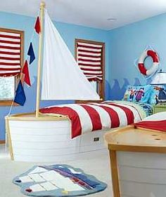 Jack's pirate room: white bed (not a boat bed though, sorry kid) with that white/red quilt