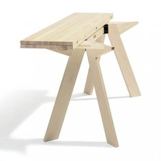 Simsalabim by Börge Lindau. One table folds to half size, allowing two tables to occupy the same space as one.
