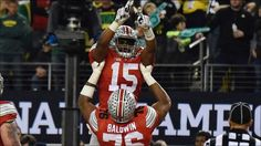 Ezekiel Elliott and Darryl Baldwin: Jan 12, 2015; Arlington, TX, USA; Ohio State Buckeyes running back Ezekiel Elliott (15) celebrates a touchdown during the third quarter against the Oregon Ducks in the 2015 CFP National Championship Game at AT&T Stadium. Mandatory Credit: Kirby Lee-USA TODAY Sports