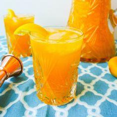 Fresh pureed mango mixed with fresh squeezed lemons + lemon Italian soda mix up for a refreshing cocktail!