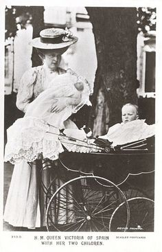 Queen Victoria Eugenie of Spain with her two eldest sons. Infante Jaime of Spain (held) and Alfonso, Prince of Asturias
