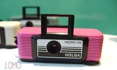 first 110 camera it was a fancy one too with the flip up viewer but I think mine was purple.